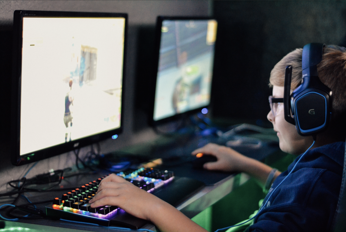 Kid playing computer games
